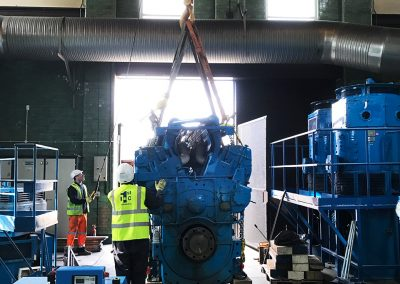 Pic from inside showing the 1st Industrial team lifting the generator plant out using an internal crane