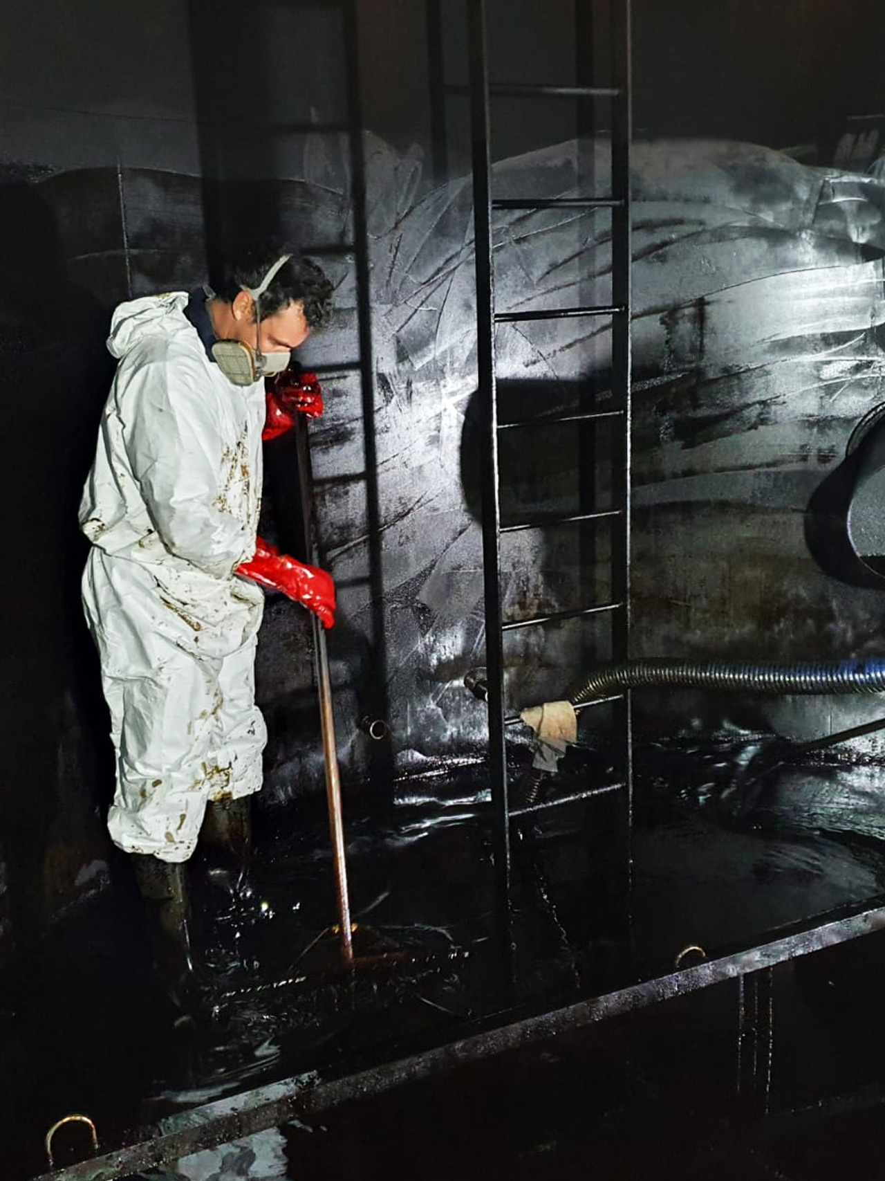 Pic showing a member of the 1st Industrial team on a tank clean at Conquest Hospital