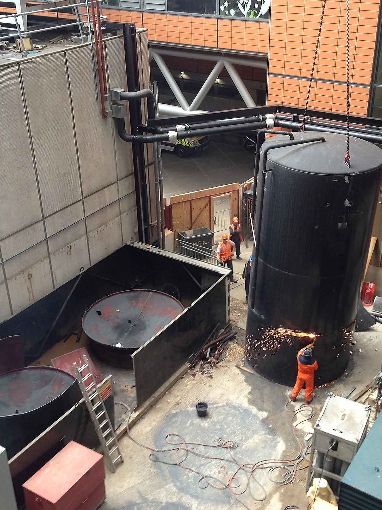 Pic of the 1st Industrial team working on a tank decommissioning job at a London Hospital