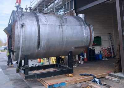 Pic showing one of the boilers before being crane lifted onto the waiting transport