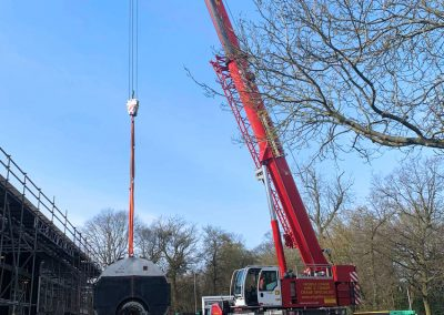 Pic showing one of the decommissioned boilers from Broomfield Hospital being lifted onto the waiting flatbed transport
